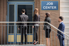 Businesspeople Standing Outside Job Center