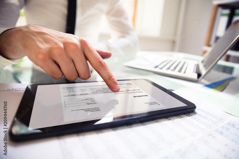 Fototapety, obrazy: Businessperson Analyzing Invoice On Digital Tablet