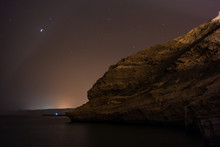 The Arabian Night On The Sea Of Oman, With Reflections, Stars And Steep Cliffs - 2