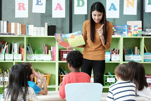 Fototapeta Young asian woman teacher teaching kids in kindergarten classroom, preschool edu