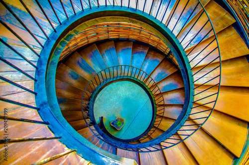 The spiral staircase wood idecoration interior in the hotel at pattaya in Thailand.