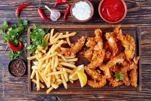 Fototapeta deep-fried shrimps with french fries, flat lay obraz