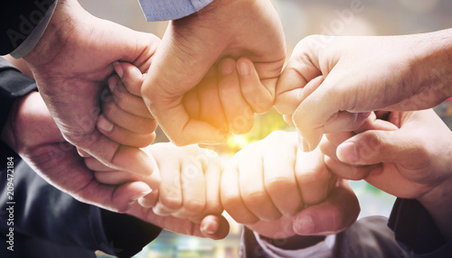 Business people team joining hands. Fototapet