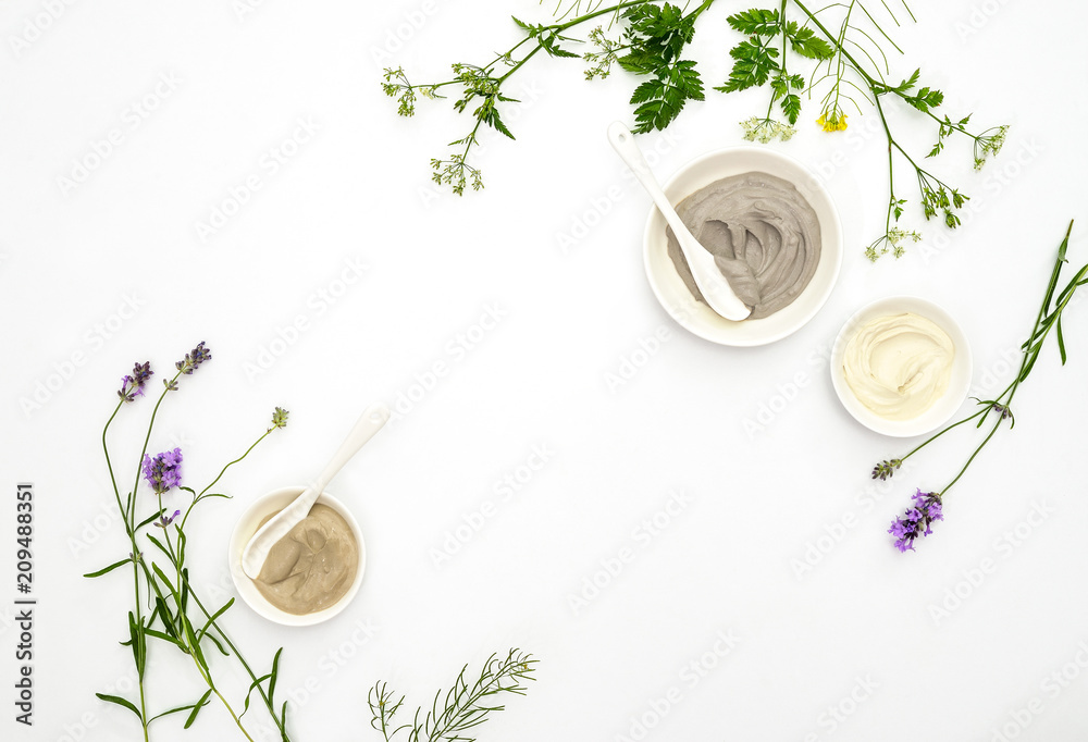Fototapeta Natural cosmetics concept with various kinds of cosmetic clays and herbs