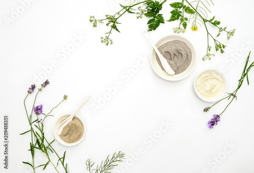 Natural cosmetics concept with various kinds of cosmetic clays and herbs