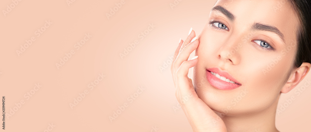 Fototapeta Beautiful brunette girl touching her face. Perfect fresh skin. Spa beauty portrait. Youth and skincare concept, cleansing