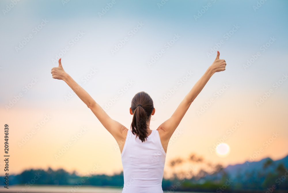 Fototapeta Young woman feeling happy and positive. Motivational concept.