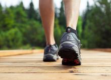 Take A Walk In Nature. Closeup Of Feet Walking Outdoors.