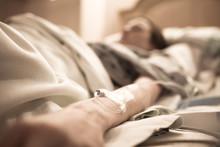 Unrecognizable Sick Woman Lyin...