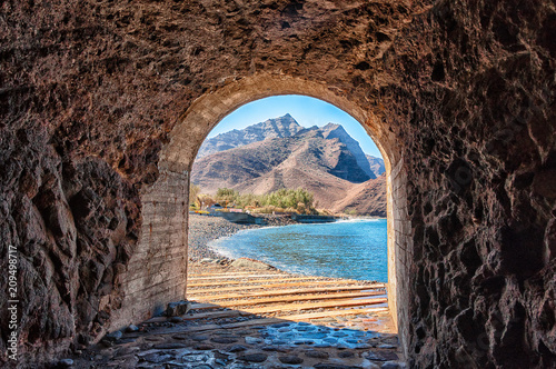 Poster Canary Islands Access tunnel to the beautiful LA Aldea beach in Gran Canaria
