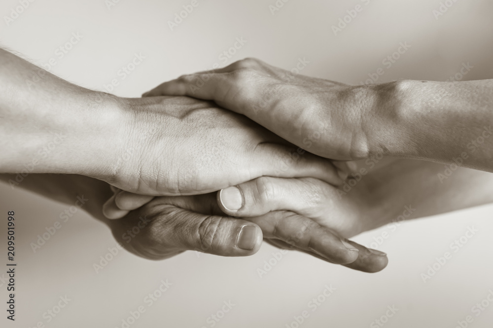 Fototapeta Two people's hands united. People working together, teamwork concept.