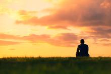 Alone Man Watching The Sunset.