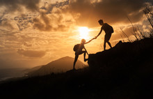 People Helping Each Other Up A Mountain. Adventure, Taking Risk,  And Teamwork Concept.