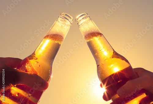 Papiers peints Biere, Cidre Cheers with ice cold beer on hot summer day. Party and celebration concept.