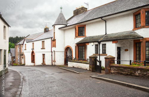 Winding street with old houses in Doune, the district of