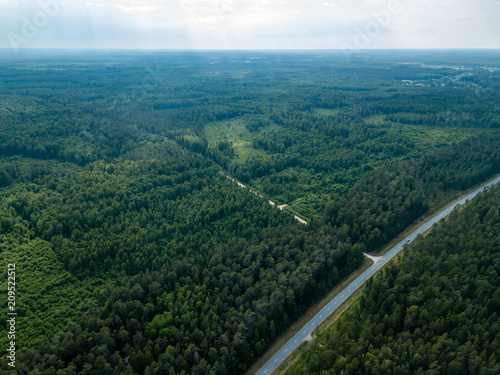 In de dag Blauwe jeans drone image. aerial view of Baltic sea shore with rocks and forest on land and highway near water