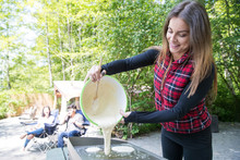 Woman Pouring Pancake Batter F...