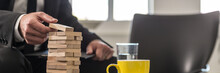 Wide Panorama View Of Businessman In Office Building A Tower Of Stacked Blocks