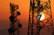 canvas print picture - Workers are climbing to repair the telecommunication tower or poles,Red sky sunset background