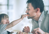 Dad and daughter eat pizza - 209550389