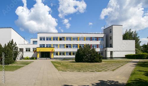 Obraz Public school building. Exterior view of school building with playground. - fototapety do salonu