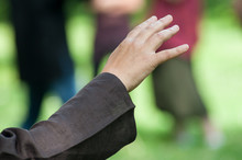Closeup Of Hands Of Woman Making Tai Chi In Urban Park