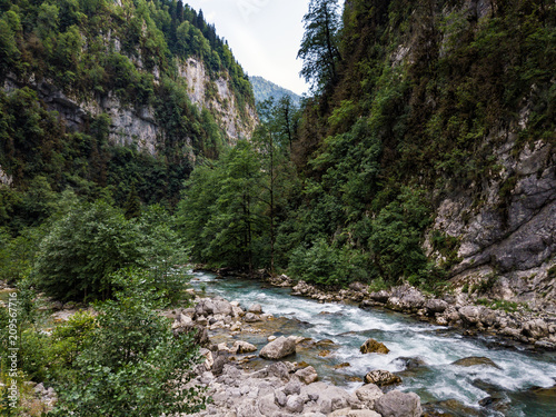 Foto op Aluminium Rivier The mountain river flows among the rocks in the mountain canyone