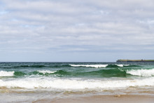 Looking Towards Noss Head And It's Lighthouse From Sinclair's Bay Near Wick In Caithness, Scotland.