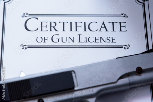 Fotografía  Hangun laying on a Gun / Firearms License Certificate