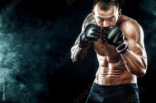 Sportsman boxer fighting on black background Tableau sur Toile