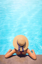Woman With Brown Hat Relaxing ...