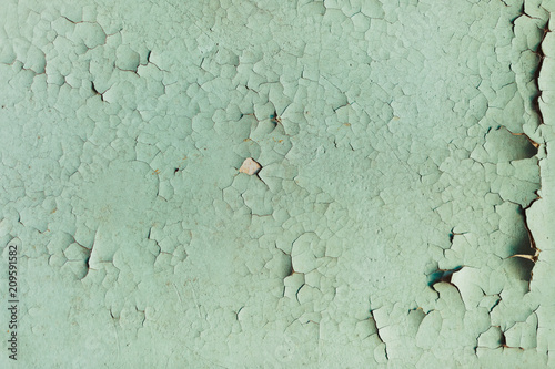Fotografía Textured background cracked blue paint on a wooden surface