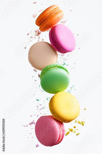 Photo sur Aluminium Macarons Macaron Sweets. Colorful Macaroons Flying