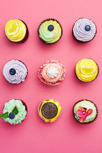 Colorful Cupcakes On Pink Background