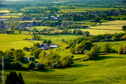 Fotografie, Obraz View across farmland in Gloucestershire showing fields and hedgerows, taken from