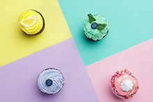 Cupcakes Desserts On Colorful Background