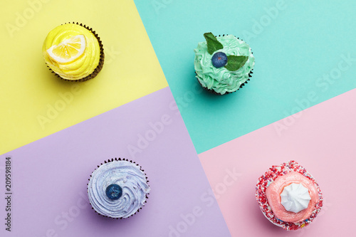 Fototapeta Cupcakes Desserts On Colorful Background obraz