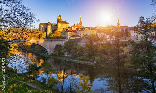 Fotografie, Obraz  Colorful town Loket in autumn over Eger river in the Sokolov District in the Kar