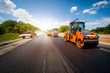 canvas print picture - industrial landscape with rollers that rolls a new asphalt in the roadway. Repair, complicated transport movement.
