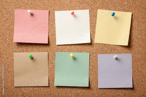 Fototapeta Colorful blank sticky notes on cork board obraz