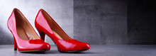 Composition With A Pair Of Red High Heel Shoes