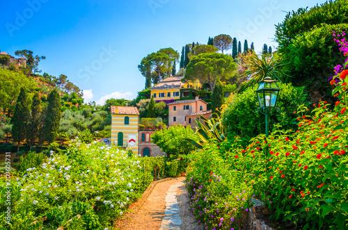 Beautiful traditional street with flowers of the Portofino,  Liguria, Italy