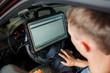 man conducts computer diagnostics of car faults