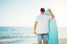 Portrait Of Happy Surfer In Ha...