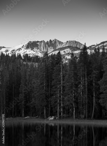 Fotografie, Obraz  Sunrise over Sierras in California with trees and lake in the foreground in blac