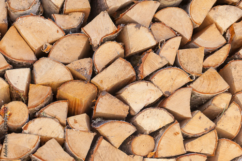 Tuinposter Brandhout textuur Firewood background, chopped firewood on a stack.