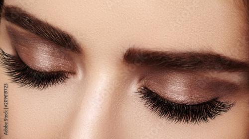 Fényképezés  Beautiful female eye with extreme long eyelashes, black liner makeup