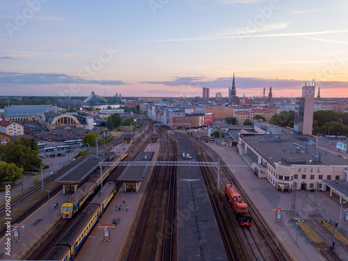 Wall Murals Northern Europe Riga, Latvia. June 10, 2018. Aerial view on the Riga central train station during beautiful sunset.