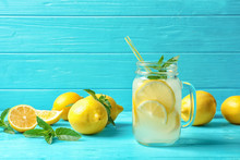 Natural Lemonade In Mason Jar On Wooden Table