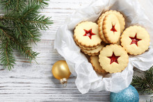 Traditional Christmas Linzer Cookies With Sweet Jam In Wooden Crate On Table, Top View